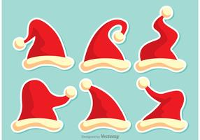 Set Of Red Santa Hats Vector