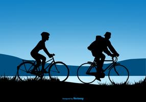 Silhouette Design Of A Couple Riding Bicycles