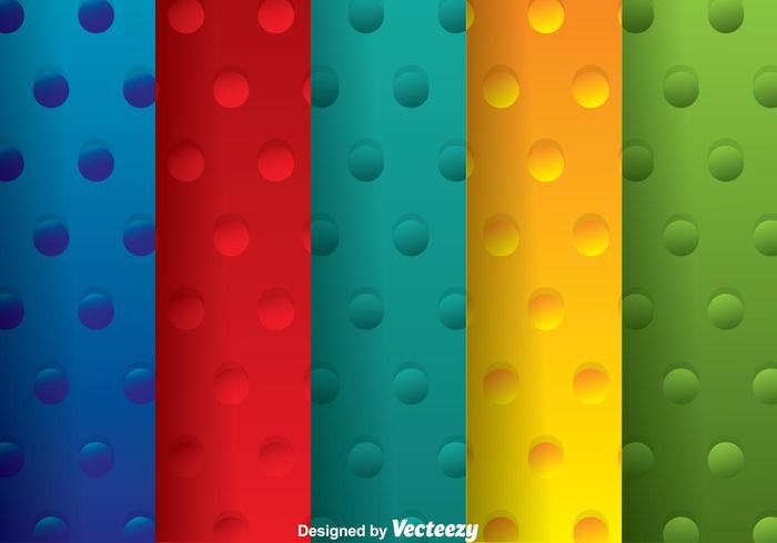 Ensemble de motifs à pois multicolores vecteur