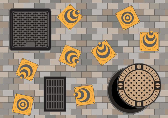 Manhole en la carretera de adoquines