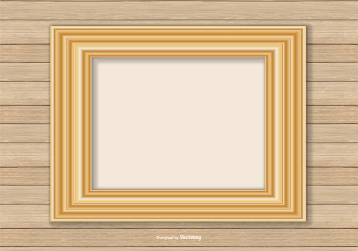 Cadre en or sur fond de mur en bois