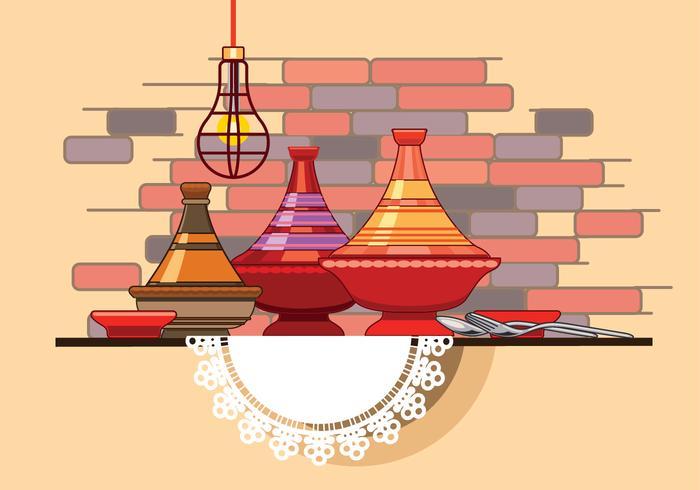 Collection marocaine Tajine avec cuillère et fourchette devant le mur du restaurant