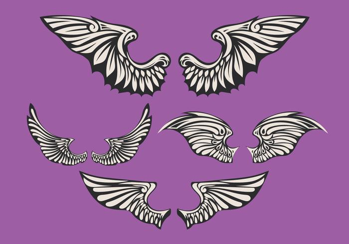 Set di ali bianche con sfondo viola vettore