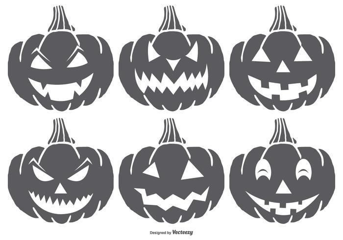 Amanecer de la mano Spooky Halloween Pumpkins vector