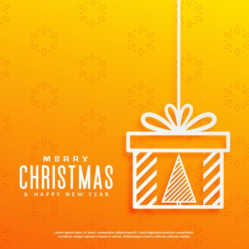 yellow background with christmas tree inside a gift box design