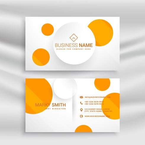 white business card with yellow circles