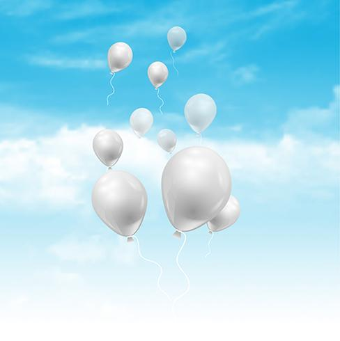 Balloons floating in a blue sky with fluffy white clouds