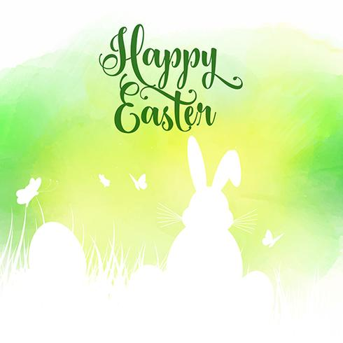 Easter background with silhouette of bunny in grass on a waterco