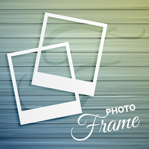 two empty photo frames on wooden background