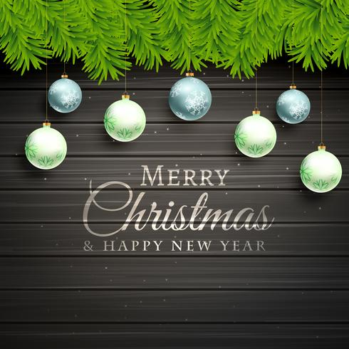 christmas balls and pine tree leafs on wooden background