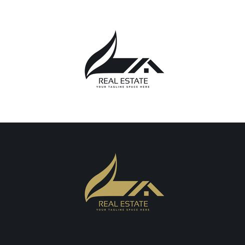 real estate logo design with house and leaf shape