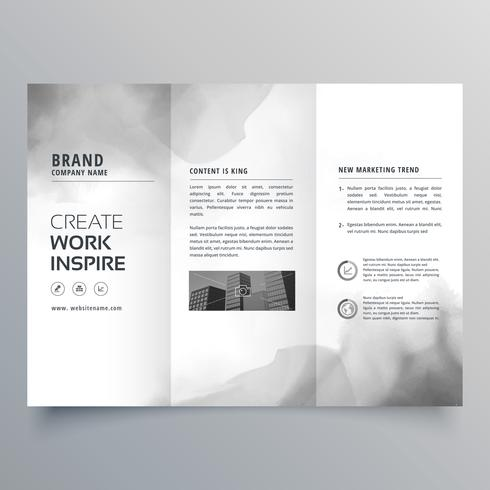 trifold brochure with black ink stain design