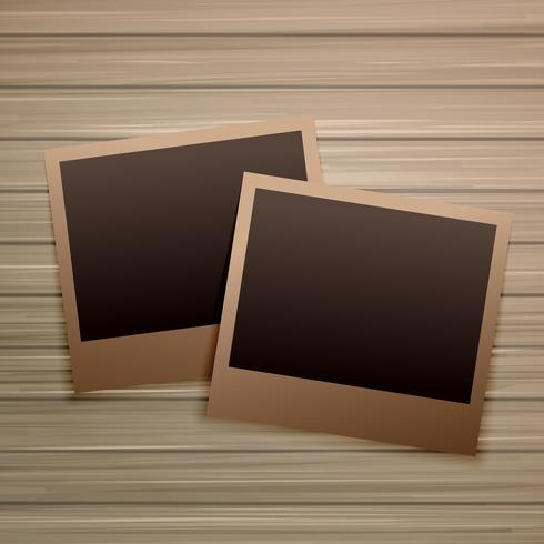 old photo frames on wooden background