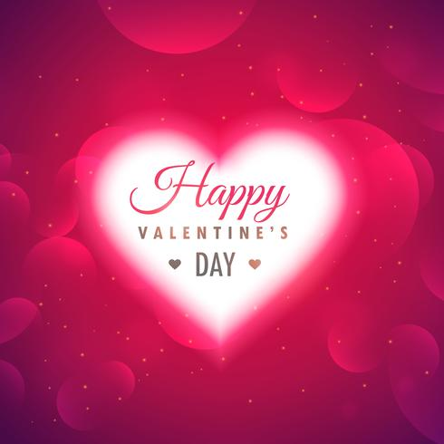 beautiful glowing heart on pink background for valentine's day