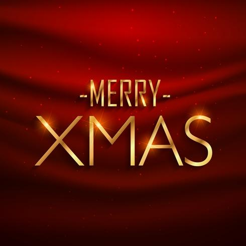 golden merry xmas lettering on red silk background