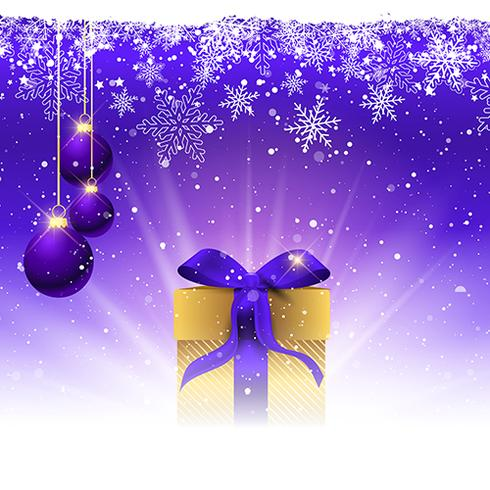 Christmas gift with purple ribbon nestled in snow