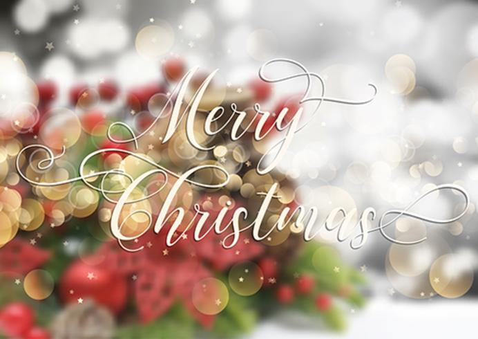 Decorative Christmas text on defocussed image