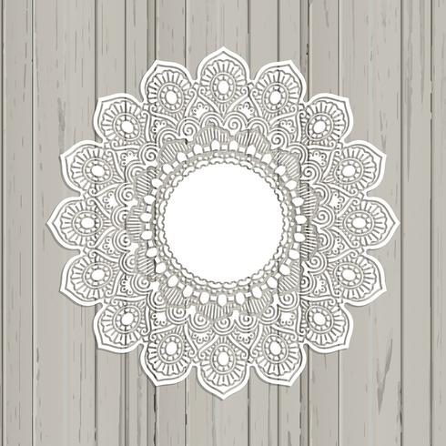Lace style mandala on a wooden background