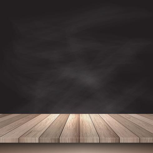 Wooden table against chalkboard background