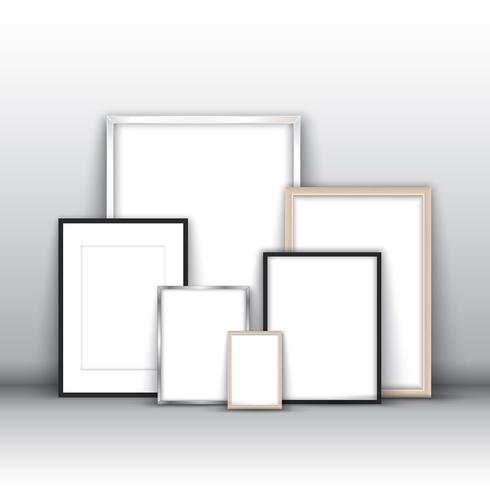 Blank picture frames against a wall