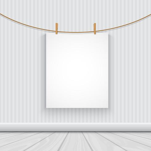 Hanging blank picture in a room