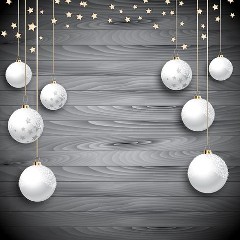 Hanging Christmas baubles on a wooden background