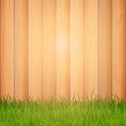 Grass on wooden background