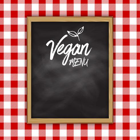 Vegan menu chalkboard on a checked cloth background