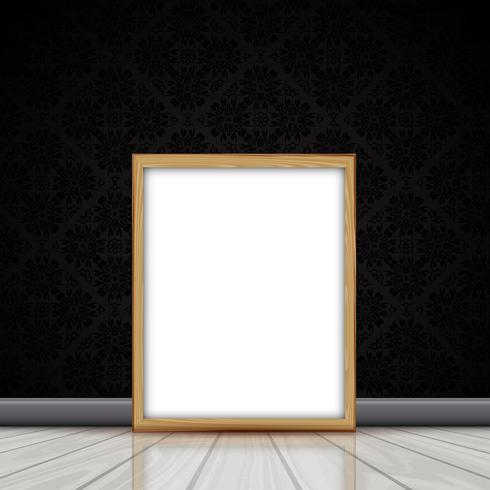 Blank picture with wooden frame leaning against wall