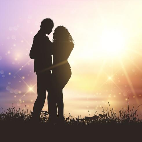 Valentine's couple in grassy sunset landscape
