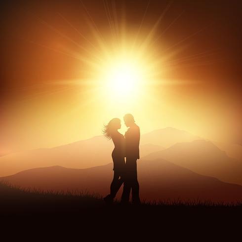 Silhouette di una coppia in un paesaggio tramonto