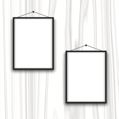 Blank frames on wood background
