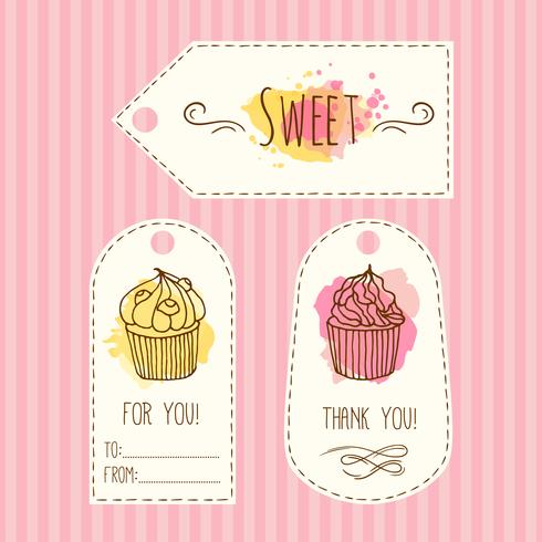 Tags with cupcake illustration. Vector hand drawn labes set  watercolor splashes.