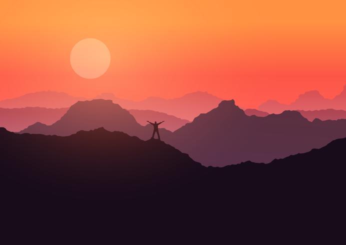 Mannen stod på bergslandskapet vid solnedgången