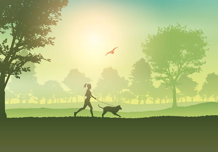 Femmina che pareggia con il cane in campagna