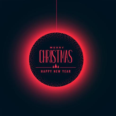 boule de Noël rougeoyante sur fond sombre
