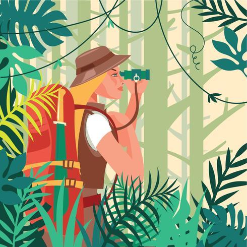 Mujer caminando en la jungla con cuchillo y binoculares