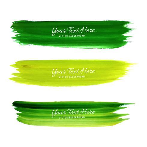 Conjunto de design de traçados de pincel aquarela verde