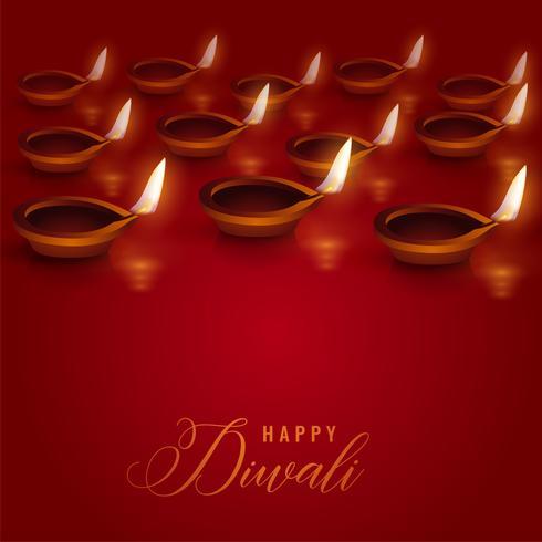 brennende Diya-Lampen auf rotem Grund für Diwali-Festival platziert