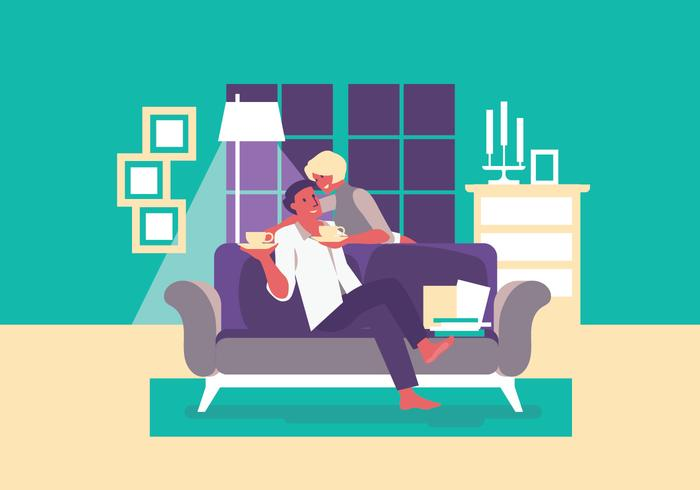 Hustru och man slappna av tillsammans med kaffe på soffan