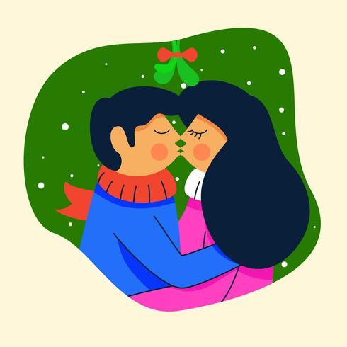 couple standing under mistletoe