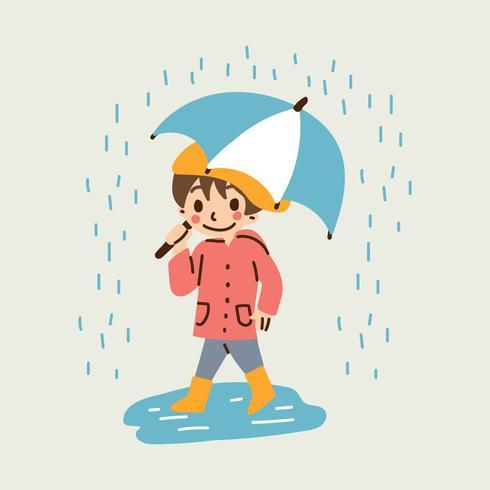 Ragazzo carino che tiene un ombrello