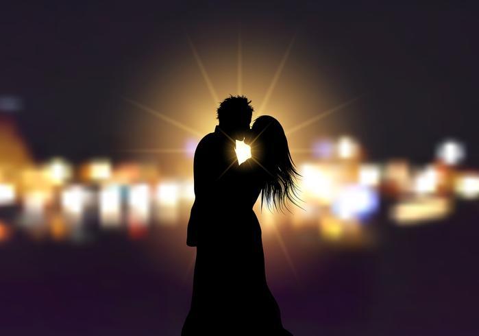 Silueta de una pareja amorosa sobre fondo de luces bokeh