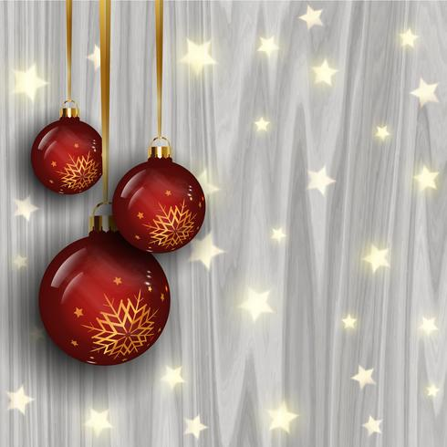 Christmas baubles on a wooden texture