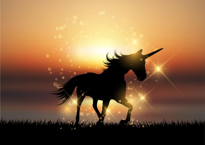 Silhouette di un unicorno in un paesaggio tramonto vettore