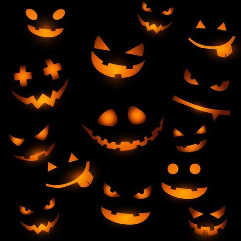 Sfondo di Halloween con facce incandescente di zucca vettore