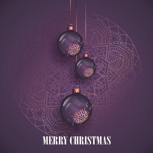 Hanging Christmas baubles on a decorative mandala design