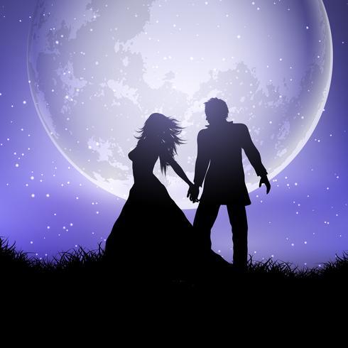 Silhueta de casal de noivos contra um céu ao luar