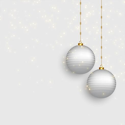 beautiful christmas balls on snowy background