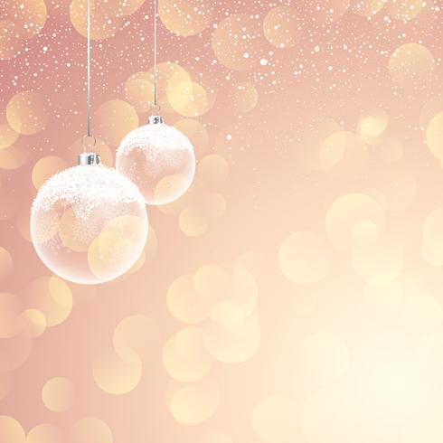 Snowy Christmas baubles on bokeh lights background